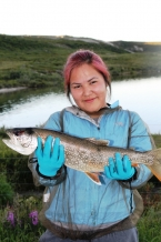 Summer student Teya Wetrade with one of the four Lake Trout she caught at Daring Lake this summer  (Photo:  GNWT/Stephanie Yuill)