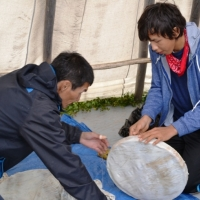 Roman learning how to make a Dene drum