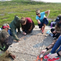 Roman Lamouelle (second from left) taking part in caribou photo survey exercise during Tundra Science and Culture Camp